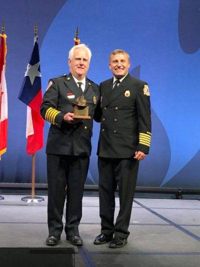 The CT Fire Chiefs Assoc. Congratulates Chief TIm Wall of the North Farms (Wallingford) FD on receiving an IAFC President's Award presented at the Opening Session of FRI 2018. Later in the day, the IAFC VCOS section presented Chief Wall with a gift and elected him to Chairman Emeritus. Thanks Chief Wall for your Leadership and many years as VCOS Chair.